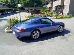 AWD Porsche 911 Carrera 4, looks/sounds/performs like new.