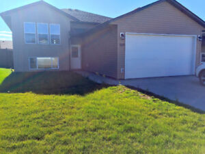 NEWER 3 BED HOME W/ DOUBLE GARAGE & FENCED YARD