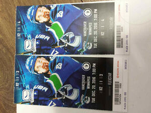 2 Canuck tickets Sec 112,row 1 seat 3&4