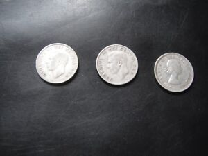 Coins - Three Canadian 25-cent Silver coins - 1948, '52, '54