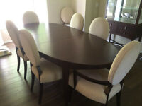 Dining table with 8 upholstered chairs and glass hutch