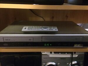 DVD/VHS Combo player and movies for sale