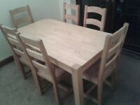 Solid pine table and 6 chairs.