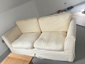 Two cream sofas £200 each and one green chair £75 ONO