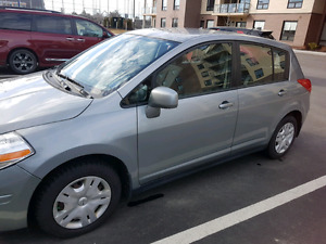 Nissan Versa- well kept and driven car