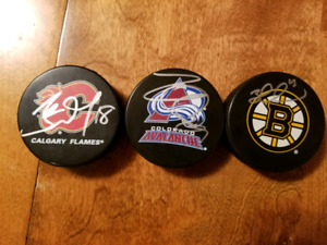 Signed Nathan Mackinnion and James Neal pucks
