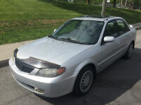 2002 MAZDA PROTEGE  MANUEL ,AC , 4 CYLINDRE , TOIT OUVRANT