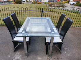 Table and chairs .