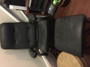 Black swivel chair with ottoman