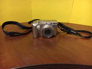 Nikon digital camera & brand new tripod