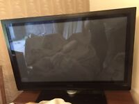 "Phillips 50"" TV with stand"