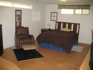 large furnished bachelor suite with private bathroom
