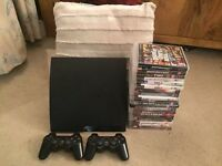 PS3, 2 controllers, 20 quality games bargain at £125