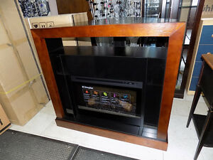 Fireplace Dimplex Corner Media $ 679.00 Call 727-5344