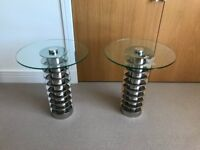 Pair of matching round glass side tables