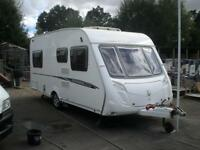 SWIFT CHARISMA 535 , 4 berth caravan with fixed rear French bed and full awning