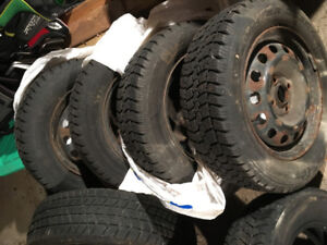 R14 snow tires for sale (two sets)