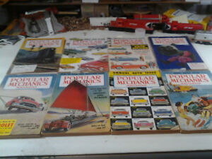 8 vintage issues of Popular Mechanics- Awesome! :)