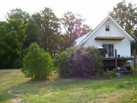 Off grid waterfront home cottage/ possible hobby farm