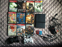 Playstation 2 slim console + 2 controllers + 2 mem cards + games