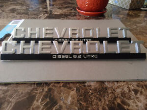 New old stock Chevrolet emblems