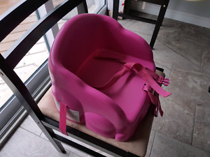 Pink booster seat for blue booster seat