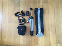 Canon EOS 1100D camera with protective case, tripod and tripod carry case