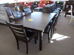 New table and six matching chairs. Sale $699.