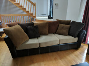 Sectional Fabric Couch with Cushions and Pillows.