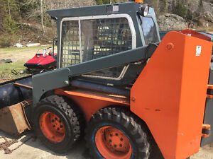 Thomas t 130 skid steer and brandnew trailer