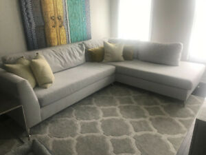 Off white lightly used fabric sectional