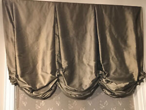 Beautiful drapes for above the sink kitchen window.