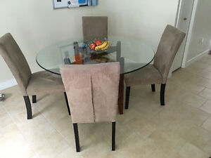 Round glass dining table with 6 chairs