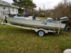 16ft aluminum fishing boat with trailer.