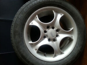 Alloy  rims . 195 60 R 15  with tires