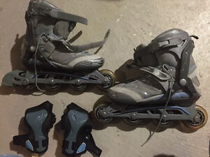 Like new Size 8 ladies rollerblades and wrist guards