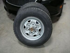 2-205 75 r14 studded snow tires on 6 bolt wheels. about 95-99%