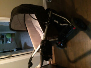 RED mountain buggy stroller like new with carrycot- 350$