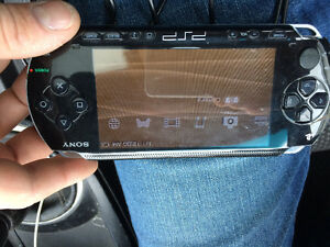 PSP WITH CAR CHARGER IN GOOD SHAPE 50 COME TAKE IT AWAY