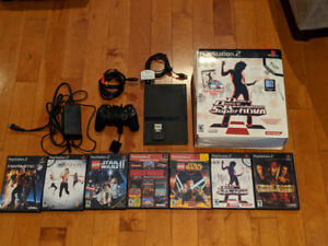 PS2 Slim Black (with accessories, cords and games included)