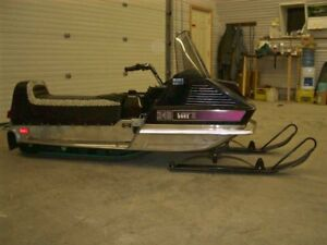 ISO cheap running snowmobile for my son