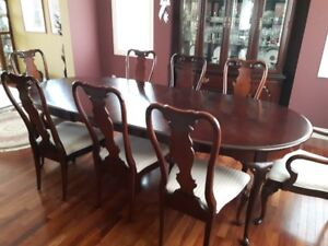 8 chair dining suite cherry wood.