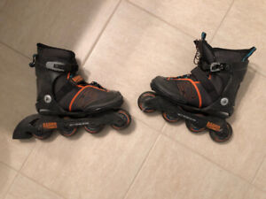 Rollerblades, one adult pair and one junior adjustable pair