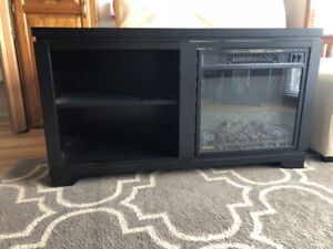 Black electric fireplace!  Only 2 years old, heats up quickly.