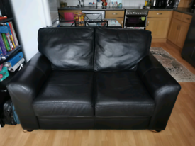 Black leather 2 sitter sofa