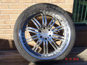 Cadillac alloy rims and tires.
