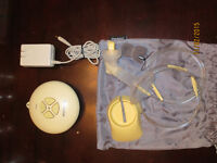 Medela Swing Electric Breast Pump with a lot of accessories!