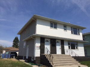 Spacious 3 Bedroom Main floor unit in a Triplex near Henderson!