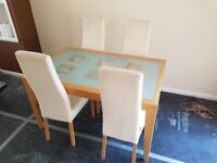 Extending Glass Top Dining Table with 4 x Cream Upholstered Chairs