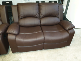 A used brown leather effect 3 x 2 reclining sofas.